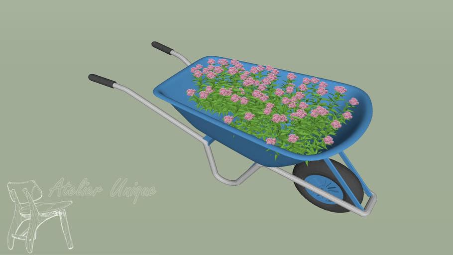 Carrinho de mão com flores para jardim