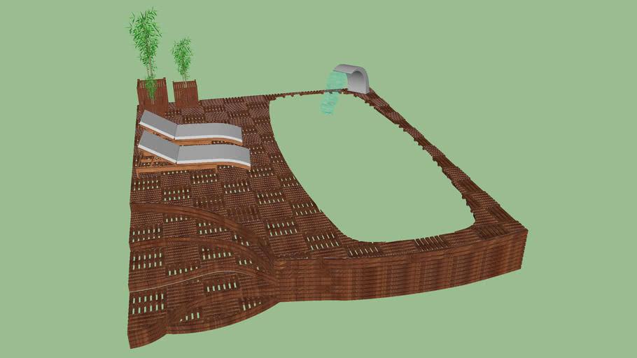 deck com piscina,espreguissadeira,cascata e plantas