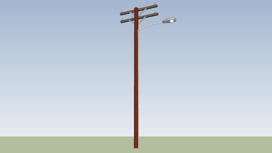 streetlight attached to wooden electrical pole