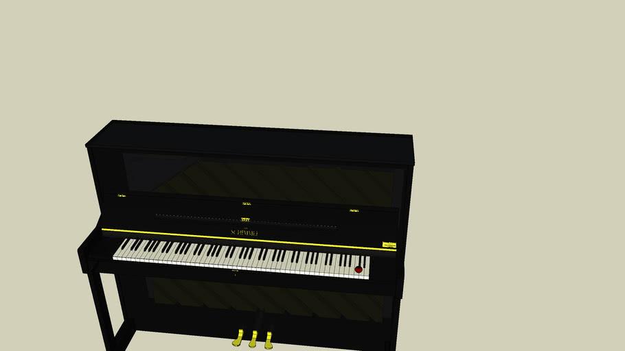 le piano avec une pomme sue le clavier