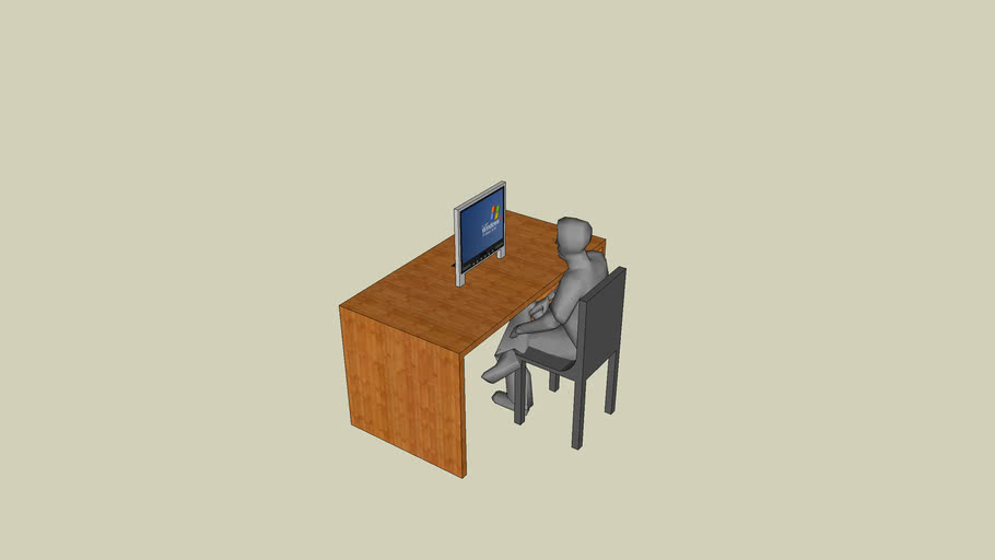Desk and chair with a computer