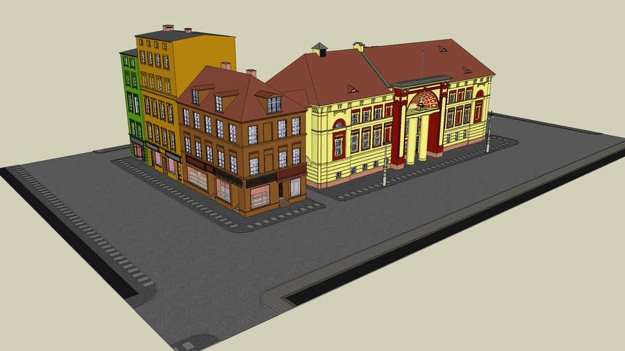 Teatr Miejski w Głogowie im. Andreasa Gryphiusa z oświetleniem przed budynkiem oraz budynki inne