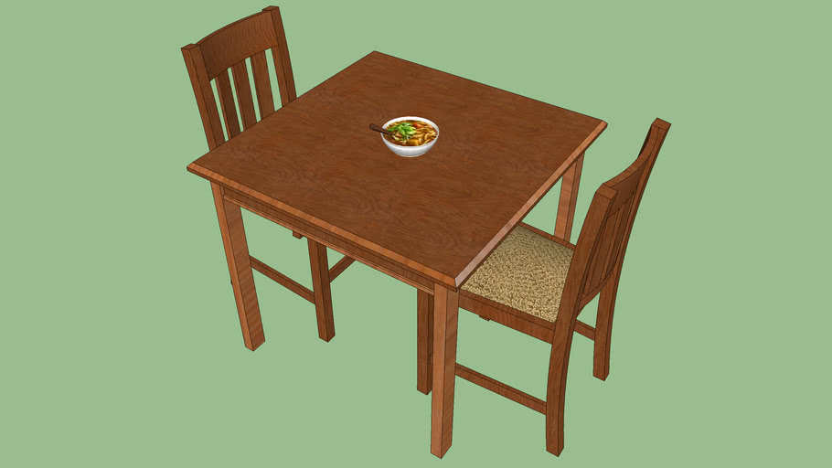 Simple wood table with two chairs and meal
