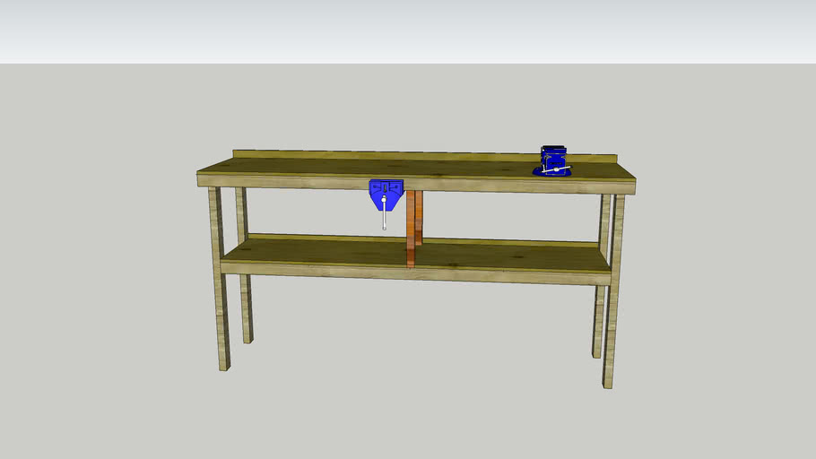wooden workbench with two vice's
