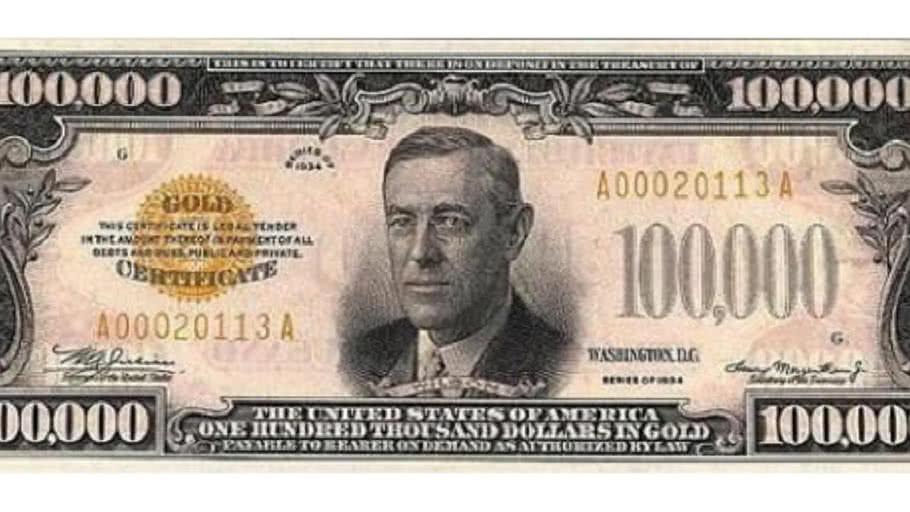 Woodrow Wilson 100,000 dollar bill in standard gold