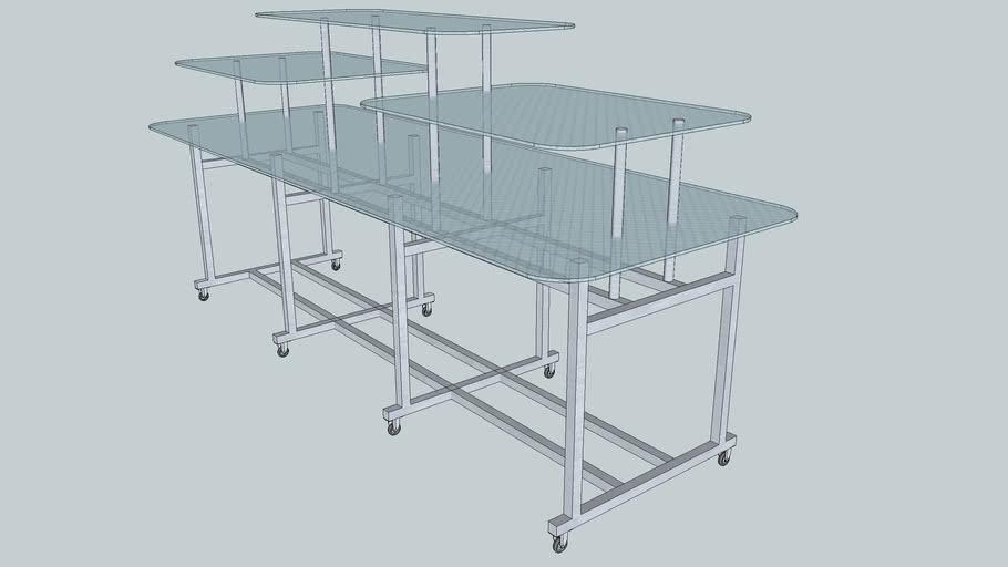 Expositor de vidro temperado tipo mesa-buffet.