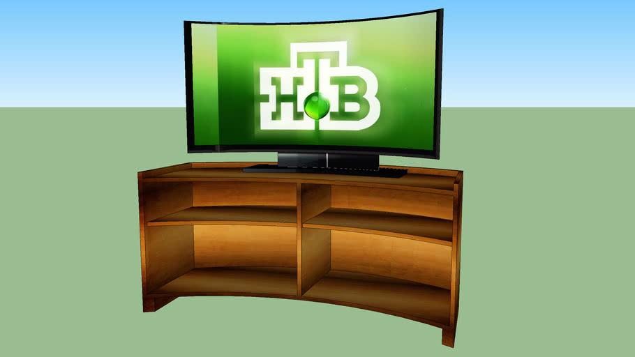 Телевизор полукруглый на тумбочке.