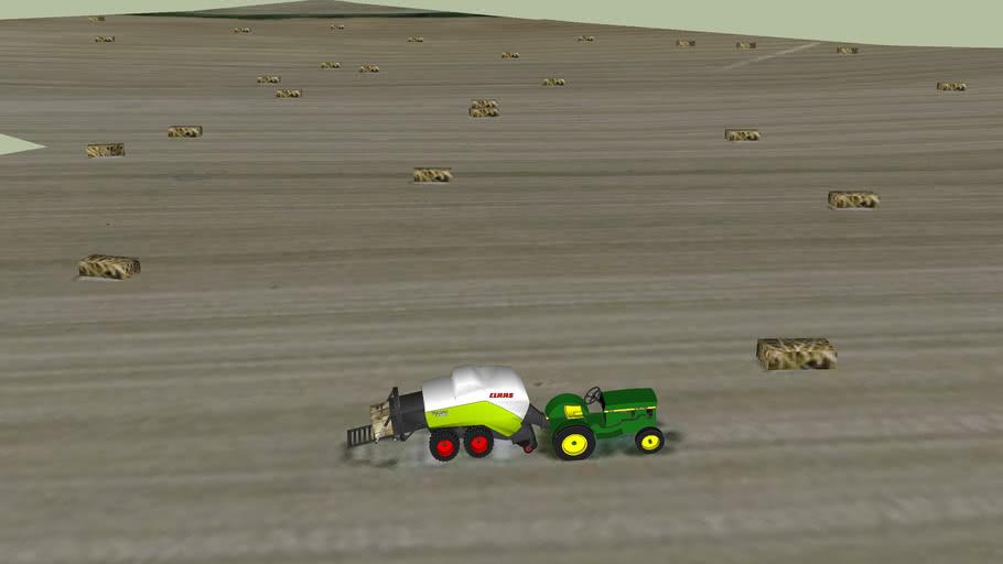 Tracteur faisant des bottes de foin