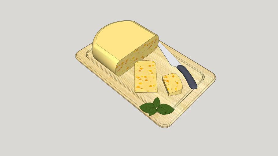 Utensílios de cozinha - Faca, tábua de madeira e queijo.