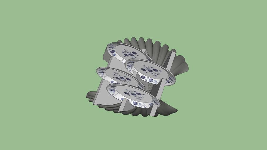Seashell-shaped plate rack