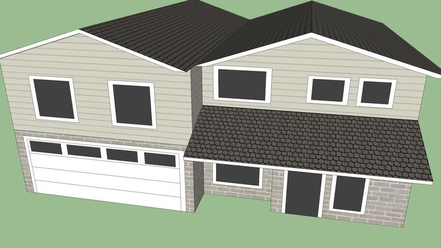 2 story tract home (tan brick and siding)