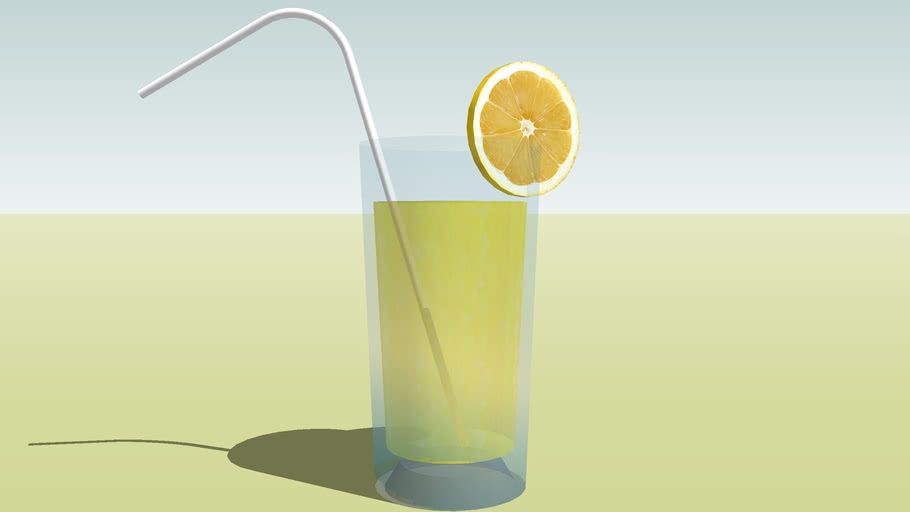 Fruit Juice with Lemon and Straw in the Glass
