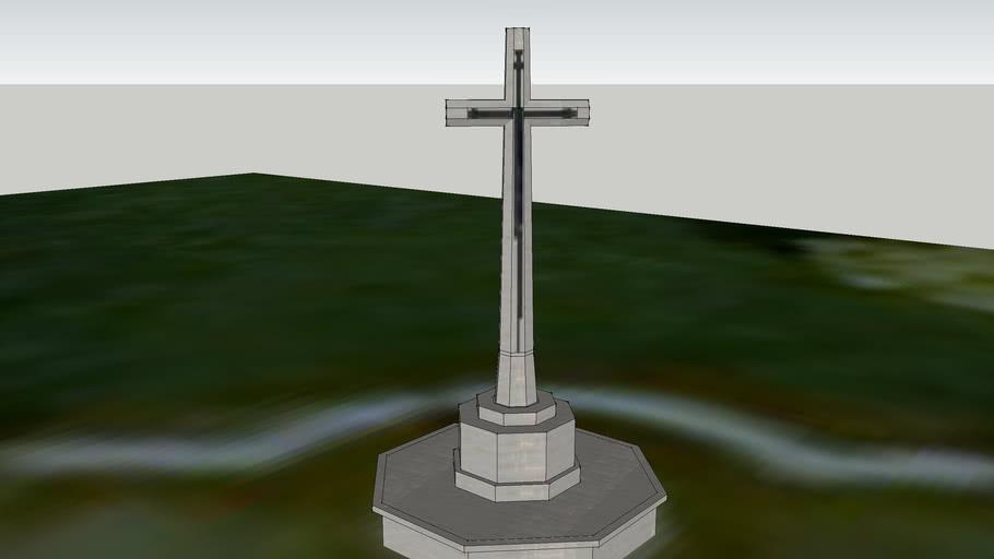 the cross of sacifice at hospital farm cemetery