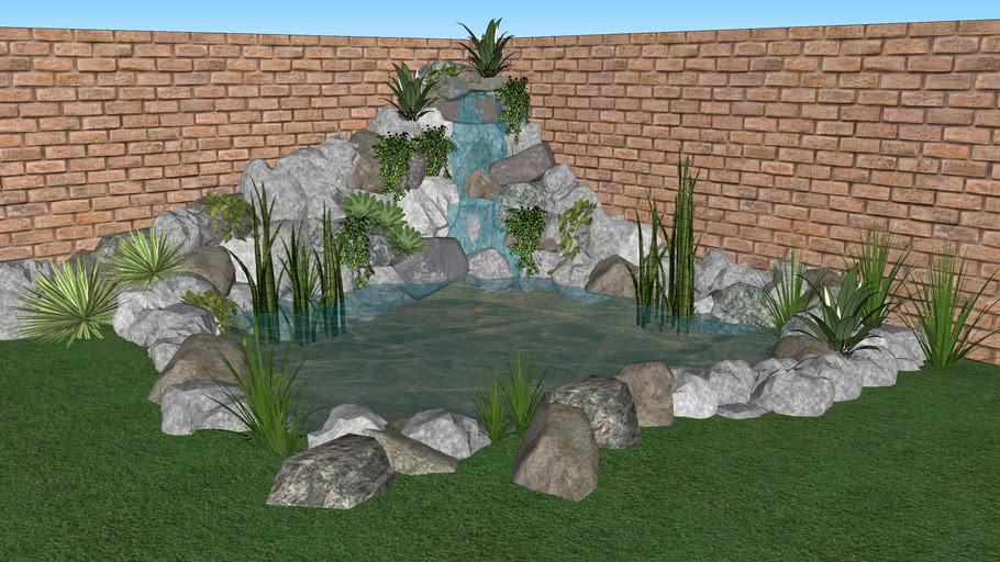 Mini lago artificial com fonte