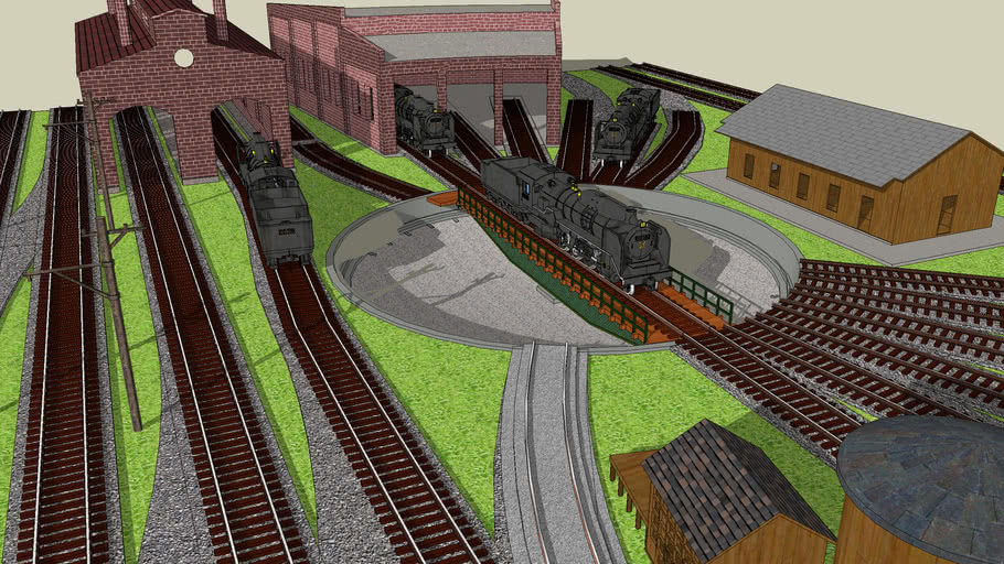 Turntable module layout with steam locomotive and roundhouse